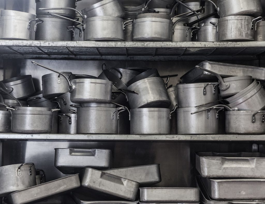Shelf Flooded with Pots and Pans