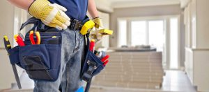 contractor with tools begins to tackle home renovation project