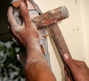 hammering at wall during demolition project