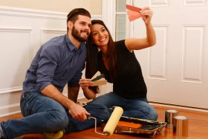 smiling couple making decisions about home remodeling improvements